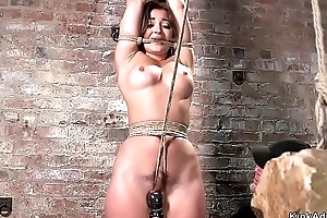 Busty floosie gets weighted crotch rope