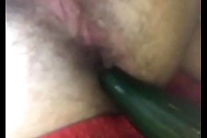 Ass fingering with cucumber