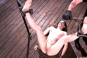 Shackled in the air doggy brunette ass whipped