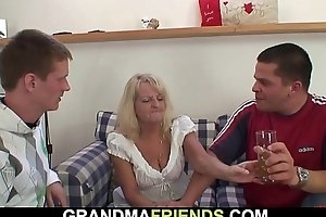 Boozed blonde grandmother takes twosome cocks