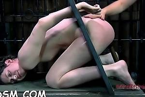Gagged angel is hoisted up on the eve of hard pussy prodding