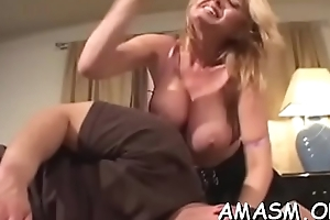 Busty feminine smothering chap with amazing titjob greater than lacing camera