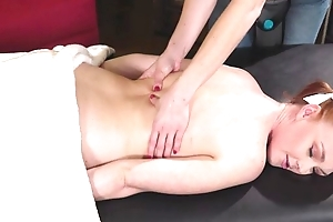 Cute redhead girl gets enticed and fucked apart from will not hear of kinky masseuse