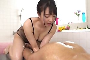 Hot Japanese piece of baggage with big natural tits licks BF's asshole