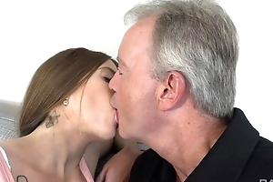 Sex-starved brunette gratifying old man on the sofa