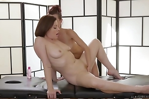 Two insatiable lesbos licking passionately by means of a massage