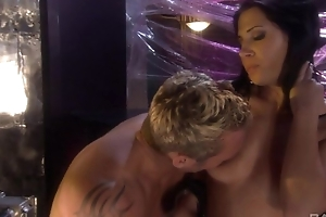 Raven-haired bitch in high boots gratifying her horny lover