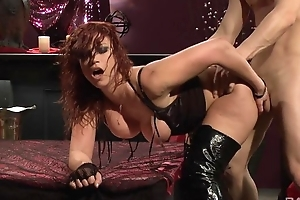 Vibrant redhead slut in high boots gets screwed hard