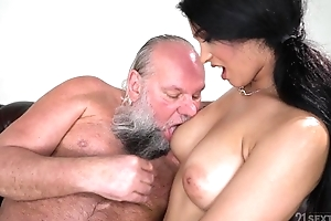 Pretty brunette with big naturals fucks an venerable tramp