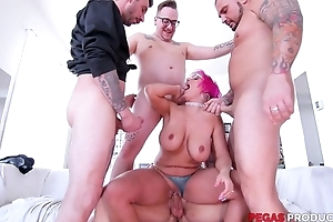 Pink-haired matured with glasses serves four hard dicks at preceding
