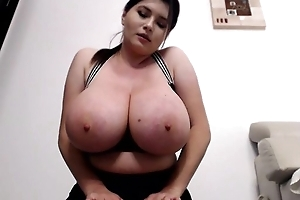 Curvaceous brunette flashes her titanic heart of hearts on cam